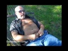 shaggy dad bear wanking on a sunny day